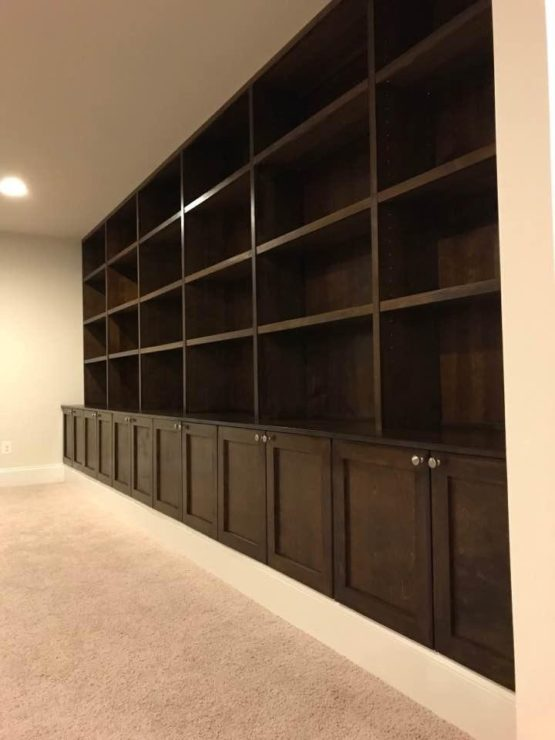 Basement storage.  Massive, dark stained wood.  Simple but nice.